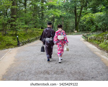 KANAZAWA, JAPAN - JUNE 9: A couple wearing traditional Japanese kimono outfits in Kenroku-en or the Six Attributes Garden on June 9, 2019 in Kanazawa.