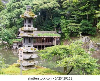 KANAZAWA, JAPAN - JUNE 9: A stone pagoda known as Kaiseki Pagoda in Kenroku-en or the Six Attributes Garden on June 9, 2019 in Kanazawa. Translation of text: Kaiseki Pagoda.