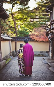 KANAZAWA, JAPAN - NOVEMBER 28: Japanese couple in kimono walking in Nagamachi samurai district. The area preserves samurai residences, earthen walls, entrance gates, narrow lanes and water canals.
