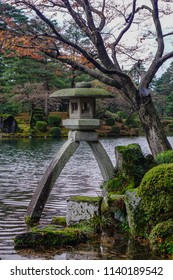 Kanazawa, Japan - Oct 4, 2017: Famous Kotoji two-legged stone lantern beside pond at Kenroku-en garden in Kanazawa, Japan.
