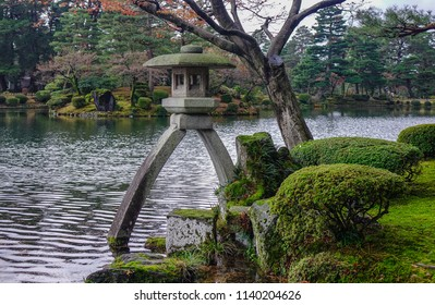 Kanazawa, Japan - Oct 5, 2016: Famous Kotoji two-legged stone lantern beside pond at Kenroku-en garden in Kanazawa, Japan.