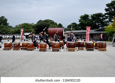 KANAZAWA, JAPAN - OCTOBER 10, 2017 : Taiko Nippon Ishikawa group's drummers are wearing traditional black clothes for performing Taiko drum show at open space of Kanazawa Castle in Japan
