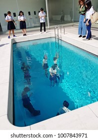 Kanazawa,Japan - Circa September 2017: One of most surprising art works among tourists at the 21st Century Museum of Contemporary Art in Kanazawa is an optical illusion Leandro Erlich's swimming pool.