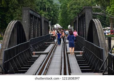 Kanchanaburi, Thailand - September 12, 2018: Train on the bridge over the river Kwai in Kanchanaburi, Thailand. River Kwai Bridge built across Kwai Yai in World War 2.
