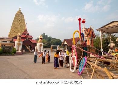 Kanchanaburi, Thailand - 17 April 2018 : Songkran Festival in the Thai-Mon style at Chedi Phutthakhaya in Sangkhlaburi, Kanchanaburi province, Thailand.