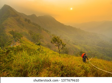 Kanchanaburi, Thailand - 28 December 2018 : Tourists are walking on a hilltop at Khao Chang Phueak National Park, Thong Pha Phum, Kanchanaburi, Thailand