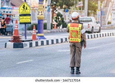 KANCHANABURI, THAILAND - APRIL 17,2019: Unidentified An employees of the traffic road police in uniforms serve on the city street on the road with transport on Songkran festival on April 17, 2019