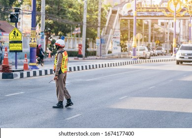 KANCHANABURI, THAILAND - APRIL 17,2019: Unidentified An employees of the traffic road police in uniforms serve on the road on Songkran festival on April 17, 2019 in Kanchanaburi, Thailand
