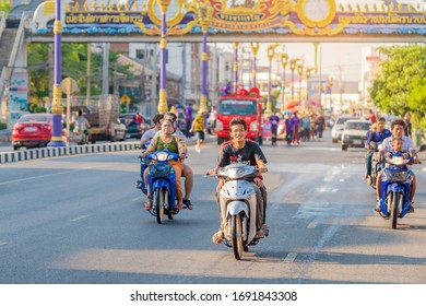 KANCHANABURI, THAILAND - APRIL 17,2019: Unidentified people celebrating Songkran by throwing water to each other on road on April 17, 2019 in Kanchanaburi, Thailand.