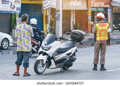 KANCHANABURI, THAILAND - APRIL 17,2019: Unidentified two employees of the traffic road police in uniforms with police motorcycles serve on the city street with transport on Songkran festival
