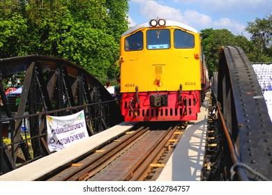 KANCHANABURI, THAILAND - DEC 6: The train on the bridge of RiveKwai on December 6, 2018in Kanchanaburi, Thailand. River Kwai bridge is a famous historical landmark of the second world war.