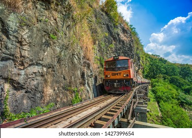 Kanchanaburi, Thailand - December 17, 2017:World war II historic railway, known as the Death Railway with a lot of tourists on the train taking photos of beautiful views over Kwai Noi River.