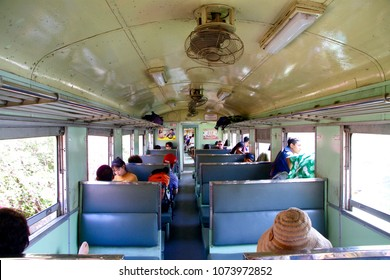 """Kanchanaburi / Thailand - Feb. 2, 2018: The tourists inside the old styled carriage of a train that operates on the famous historical heritage """"The Death Railway"""" in Kanchanaburi, Thailand."""