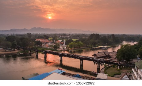 KANCHANABURI, THAILAND - February 2, 2019: Train on the bridge over the river Kwai in Kanchanaburi, Thailand. This bridge is famous for its history in second world war.