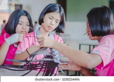 KANCHANABURI THAILAND - FEBRUARY 21 : Unidentified Local instructors teach Thai handicrafts to unidentified students on february 21,2018 at Wat Krang Thong School in Kanchanaburi, Thailand