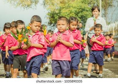 KANCHANABURI THAILAND - FEBRUARY 28 : Teachers and students of Wat Krang Thong School to make merit and candle light on Makha Bucha Day on february 28,2018 at Wat Krang Thong in Kanchanaburi, Thailand