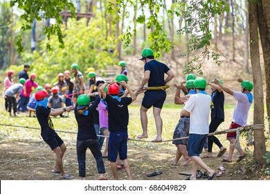 KANCHANABURI THAILAND - JAN 22, 2016 : Young people playing a team to Team building on January 22, 2016 in Kanchanaburi, Thailand
