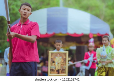KANCHANABURI THAILAND - JULY 18 :  Parade on street, in athletic game opening day of primary student in the rain on July 18,2018 at Nongthabong School in Kanchanaburi, Thailand