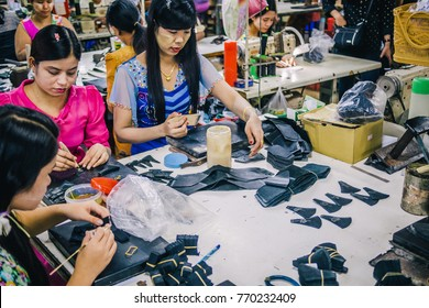 KANCHANABURI, THAILAND - JULY 22, 2017: Burmese Female Migrant Workers Sewing or Stitching Leather Shoes in footwear production line of factory in Sankhlaburi, Kanchanaburi, Thai-Burma border province