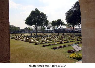 KANCHANABURI, THAILAND - MARCH 18, 2018 Commonwealth war graves, Kanchanaburi War Cemetery entrance arch with plots 2, 4 and 6