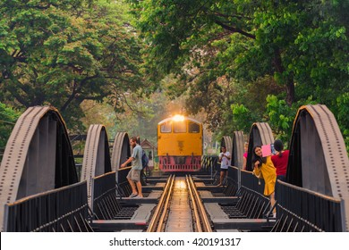 KANCHANABURI, THAILAND - March 27, 2016: Train on the bridge over the river Kwai in Kanchanaburi, Thailand. This bridge is famous for its history in second world war.
