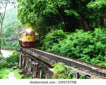 Kanchanaburi, Thailand - October 12, 2013: Local train from Namtok to Bangkok (Thon Buri) on Tham Kra Sae Bridge, the Death Railway