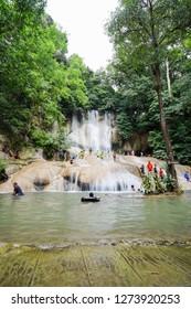Kanchanaburi, Thailand - October 20, 2018: Scenery of Saiyoknoi waterfall in Kanchanaburi, Thailand. This is one of the most waterfall in Kanchanaburi province.
