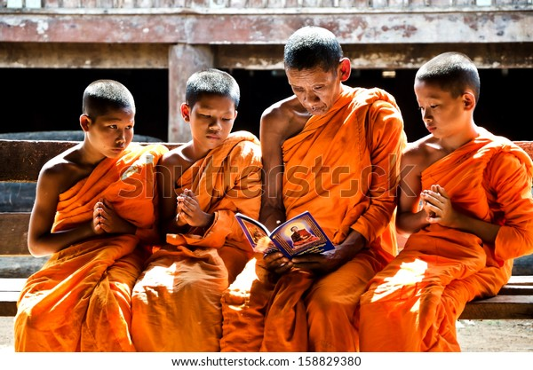 KANCHANABURI THAILAND-January 29:  An unidentified monk teach young novice monks 12-15 years old in temple on January 29, 2012 in KANCHANABURI THAILAND. Temple is the school  in rural of Thailand.