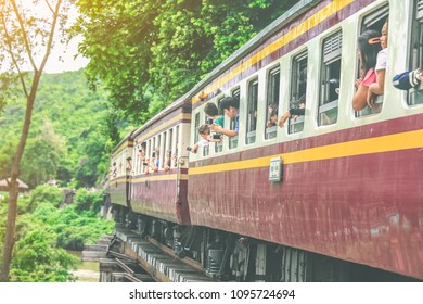 KANCHANABURI-THAILAND, DECEMBER 20, 2017 : tourist take a photo when touring trains running on death railways bridge crossing kwai river in Kanchanaburi