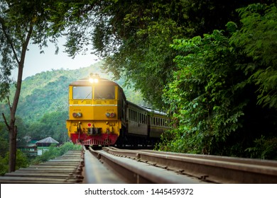 KANCHANABURI,THAILAND - December 4, 2016 : Krasae Cave or The Death Rail Way. / Train on the bridge over the river Kwai in Kanchanaburi province,Thailand.