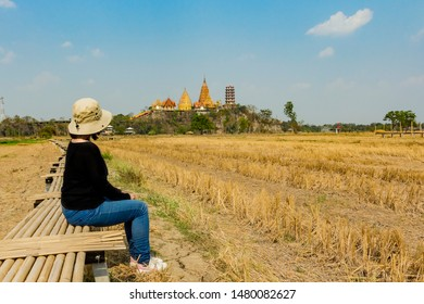 KANCHANABURI,THAILAND - Febuary 16, 2019 : Fields rice in the back of the Wat Tham Sua (Tiger Cave Temple) / Landscape of Wat Tham Sua Thai temple in Kanchanaburi province, Thailand.