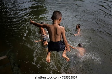 KANCHANABURI,THAILAND - June 18,2016, Children in local thai people enjoy playing in canal.