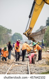 Kanchanaburi,Thailand - Mar 03 2016 : Backhoe and worker improvement construction of railway