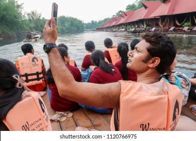 Kanchanaburi/Thailand - March 31, 2018 : Handsome indian man with life vest take photo selfie by mobile on river rafting at Wangnokkeaw riverside Resort on hoiliday