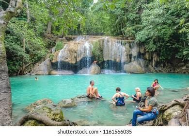 Kanchanaburi/thailand- November 21 2016 :Deep forest waterfall with tourist in erawan national park kanchanaburi ,Thailand nature travel