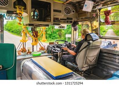 kanchanaburi/Thailand-1 July 2017:Unacquainted Driver driving bus from kanchanaburi bus terminal to thongphaphum District in the early morning.kanchanaburi city Thailand.