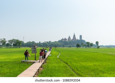 Kanchanaburi,Thailand-April 14 2018:The view of green fields and Wat Tham Sua Temple is background ,At Mee Na cafe coffee shop in Tha Muang district Kanchanaburi