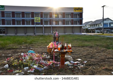 KANCHANABURI,THAILAND-APRIL20,2019 Thai spirit house Located outdoors Have your worship is placed around the carbonated water.Flowers, incense, candles,  on April 20,2019 in Kanchanaburi.