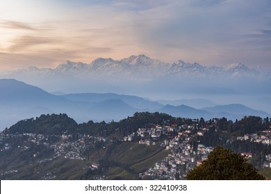 Kanchenjunga range peak after sunset with Darjeeling town in the foreground , Sikkim, India.