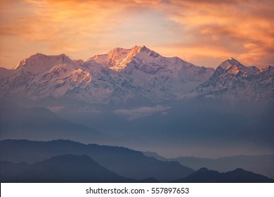 Kanchenjunga range peak in early morning light with thick mist , Darjeeling, Sikkim, India