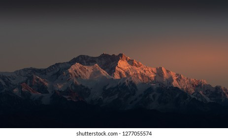 Kanchenjunga, is the third highest mountain in the world. It lies between Nepal and Sikkim, India