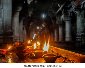 Kanchipuram, India - Circa January, 2018. View of burning candles inside Sri Ekambaranathar Temple in Kanchipuram.
