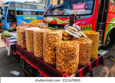 Kanchipuram, India - Circa January, 2018. Man selling snacks at the bus stand near Sri Ekambaranathar Temple in Kanchipuram.