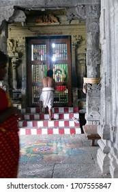 KANCHIPURAM, INDIA - DEC 26, 2019 - Brahmin priest finishing noon darshan in the Ekambareshwara Temple, 16th - 17th century, Kanchipuram, Tamil Nadu , India