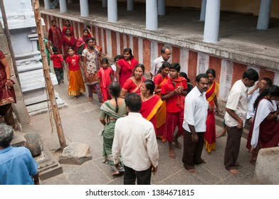 KANCHIPURAM, TAMIL NADU, INDIA, 02 DECEMBER 2017 :  Devotee at Varadaraja Perumal Temple is a Hindu temple dedicated to Lord Vishnu, that was originally built by the Cholas in 1053.