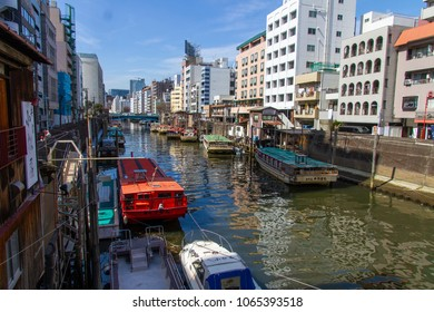 KANDA RIVER, TOKYO< JAPAN - MARCH 3RD, 2018. Traditional 'Yakatabune' pleasure boats tied up in the Kanda River in central Tokyo.