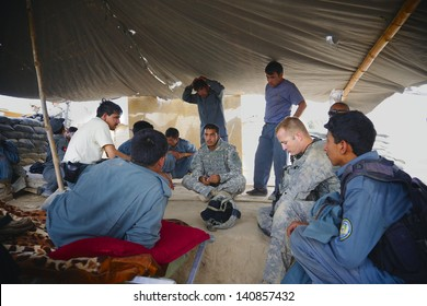 KANDAHAR, AFGHANISTAN - AUGUST 27: Afghan police discuss the events of a mission that was just completed on August 27, 2010 in Kandahar Province, Afghanistan.