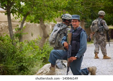 KANDAHAR, AFGHANISTAN - JUNE 1: An Afghan National Policeman strikes a pose while on patrol with ISAF forces on June 1, 2010 in Kandahar Province Afghanistan.