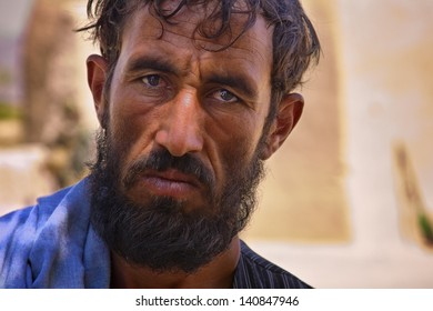 KANDAHAR, AFGHANISTAN - JUNE 22: An Afghan man's facial expression bears the strain of the conflict in his country on June 22, 2010 in Kandahar Province Afghanistan.