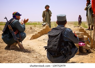 KANDAHAR, AFGHANISTAN - JUNE 27: Afghan Police mourn the death of a local village leader who was killed by Insurgents for working with ISAF on June 27, 2010 in Kandahar Province, Afghanistan.